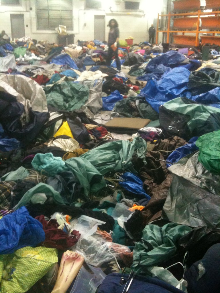 Betsy Fagin stands among a sea of tents and belonging stolen from Zuccotti Park Occupiers